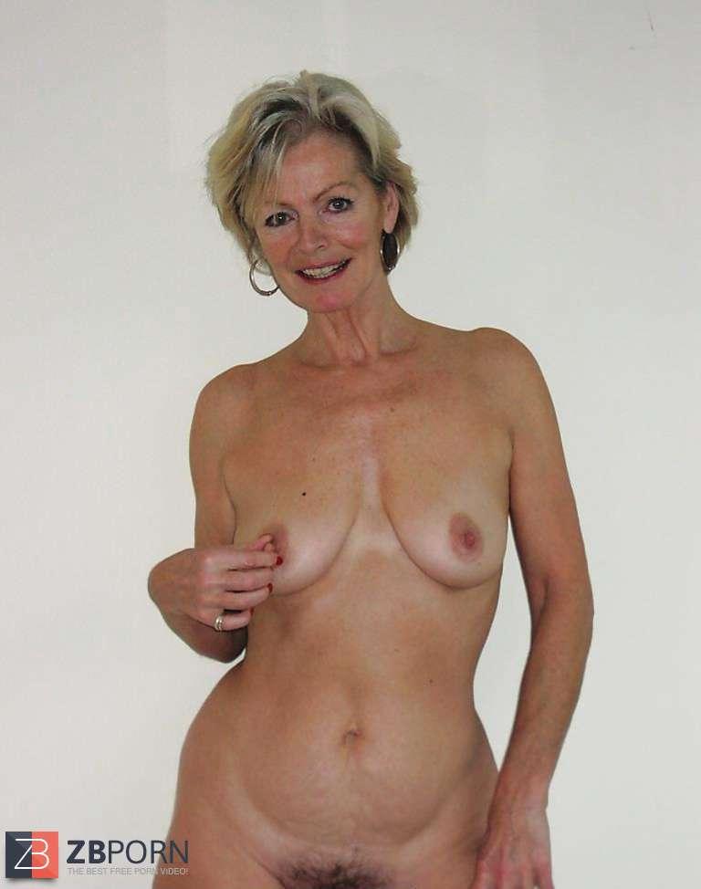 Justine A Mature Blondie Posing In A Ebony Bondage Suit  Zb Porn-1615